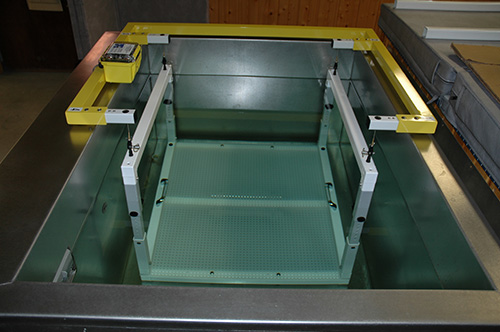 EXERTECH's standard weighing tank footprint is 58 x 47 inches. The tank is only 34 inches above the floor. No need for steps.